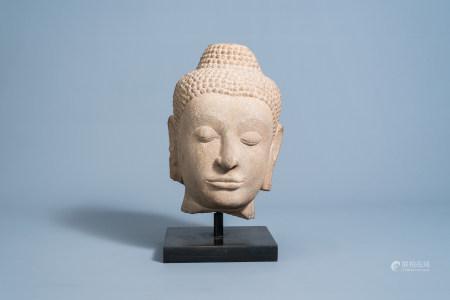 A Thai stone Buddha head, Ayutthaya kingdom, Siam, 16th/17th C.