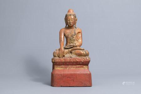 An inlaid partly gilt wood figure of a seated Buddha, Burma or Thailand, 19th/20th C.