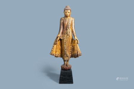 A tall inlaid gilt wood figure of a standing Buddha, Burma or Thailand, 19th/20th C.