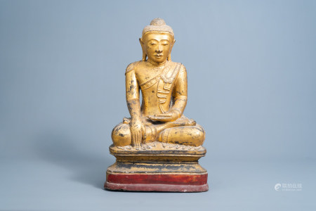 A large gilt, lacquered and polychrome decorated figure of Buddha, Burma, 19th/20th C.