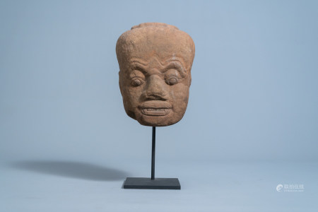 A Khmer sandstone head of a Dvarapala guardian figure, 11th C. or later