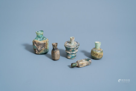 Five various soda glass bottles, jars and flasks, Roman period