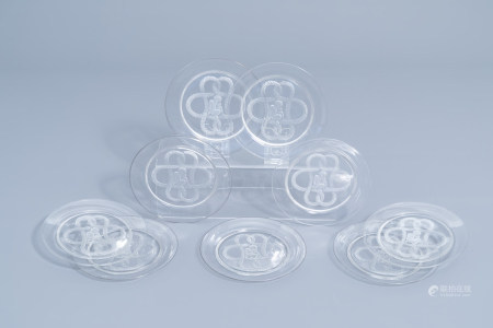 Nine French glass intaglio dishes with a putto surrounded by foliage, marked Lalique France, third quarter of the 20th C.