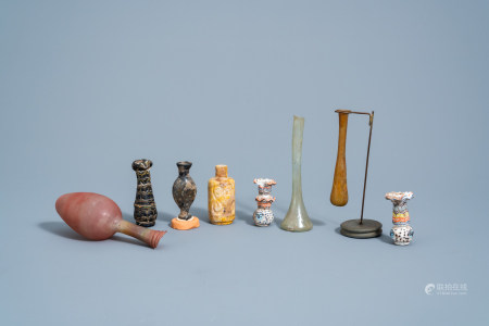 A varied collection of glass bottles and flasks, possibly Roman