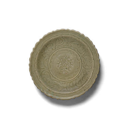 A molded and carved Longquan celadon 'peony' charger  14th15th century