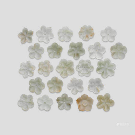 A large group of carved jade flower buttons (24)