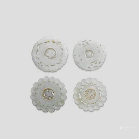 Four circular jade plaques  (4)