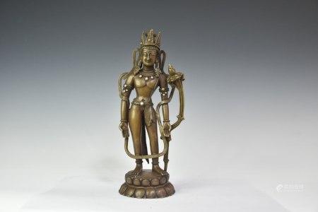 12世纪红铜镶银莲花手菩萨,