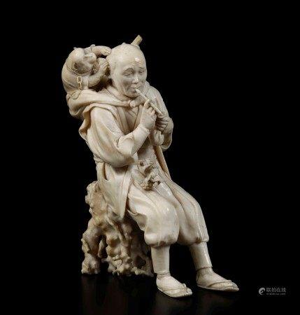 A carved ivory figure, Japan, Meiji period, A carved ivory figure, Japan, Meiji period