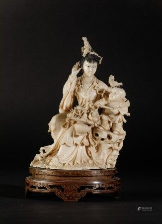 A carved ivory group, China, early 1900s, A carved ivory group, China, early 1900s