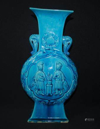 A blue glazed vase with two ears