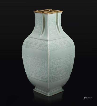 """A VERY RARE CHINESE CARVED CELADON-GLAZED PORCELAIN """"萬""""-MOUTHED VASE 珍罕粉青釉萬字口大瓶 QIANLONG SIX-CHARACTER SEAL MARK IN LOW RELIEF AND OF THE PERIOD 乾隆六字款 清 乾隆"""