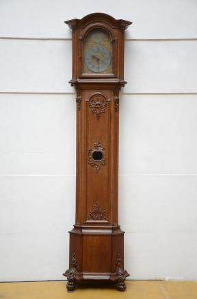 An oak standing clock (60x35x260cm)