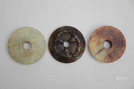 Three Chinese bi discs in hardstone (5cm)