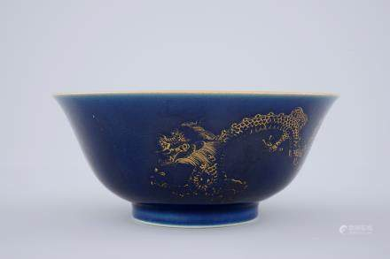 A Chinese powder blue and gilt dragon bowl, 18/19th C.