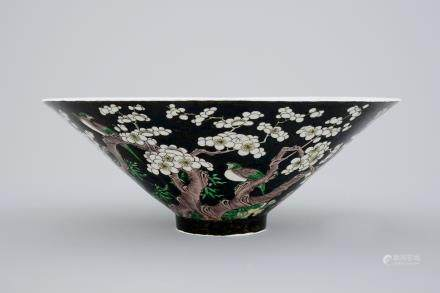 An unusual conical Chinese famille noire bowl, 19th C.