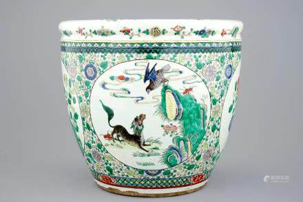 A large Chinese famille verte fish bowl with mythological animals, 19th C.