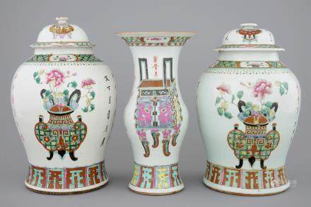 A set of three Chinese famille rose vases, 19th C.