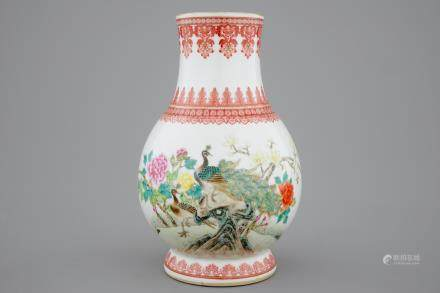 A Chinese Republic famille rose vase with a peacock, 20th C.
