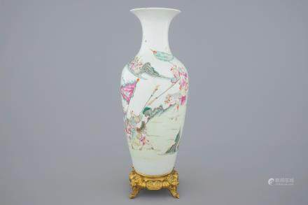 A Chinese famille rose vase on a gilt bronze stand, 18/19th C.
