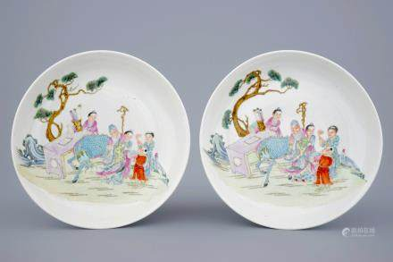 Two Chinese famille rose plates with figures and a dragon in a garden, 19/20th C.