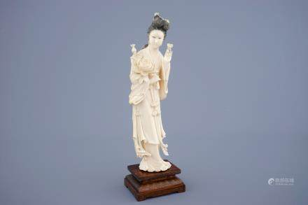 A large Chinese carved ivory figure of Guanyin on wooden base, early 20th C.