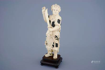 A Chinese carved ivory figure of a female warrior on a wooden base, late 19th C.