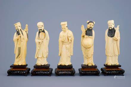 A set of 5 Chinese carved ivory figures of immortals on wooden bases, 19th C.
