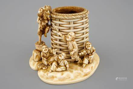 A Japanese ivory brushwasher group, Meiji, 19th C.