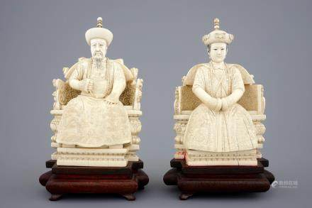 A pair of Chinese ivory figures of the emperor couple seated on a throne, ca. 1900