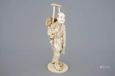 A Japanese carved ivory figure of a lumberjack, Meiji, 19th C.