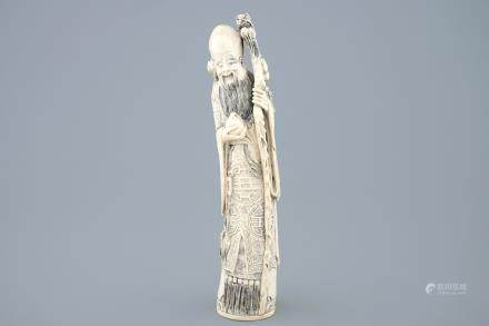 A tall Chinese carved ivory figure of Shou Lao, late 19th C.