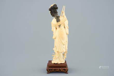 A Chinese carved ivory figure of a lady on wooden base, ca. 1900