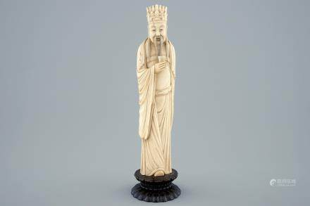 A Chinese carved ivory figure of a sage with a beaker on a lotus-shaped base, 19th C.