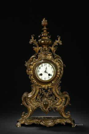 An antique bronze clock