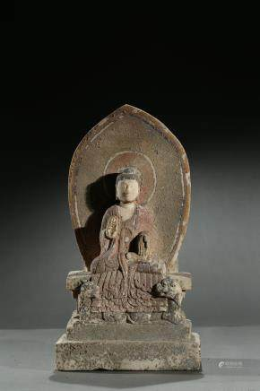 A stone carved polychromed 'buddhist' stele
