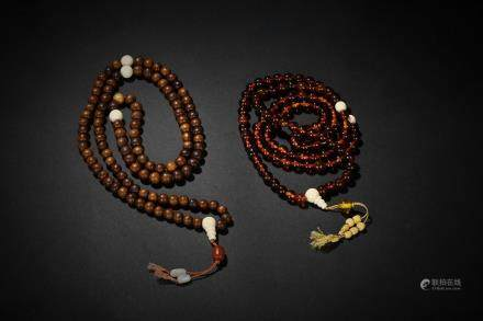 A set of two amber and jichimu prayer's beads