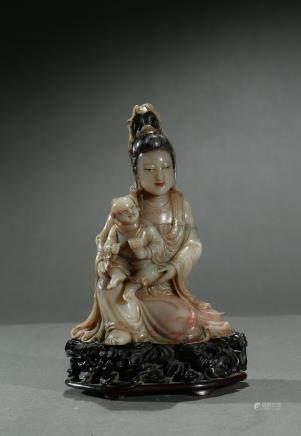 An soapstone carving of Guanyin and son