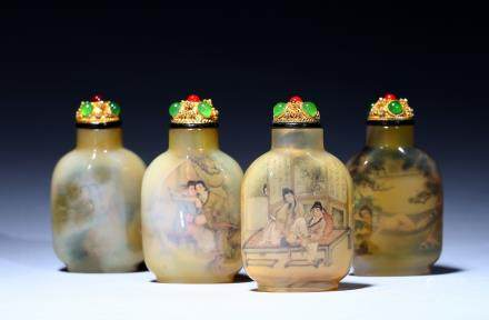 A set of four inside-painted crystal snuff bottles