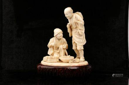 A FINE TOKYO SCHOOL IVORY FIGURAL GROUP.