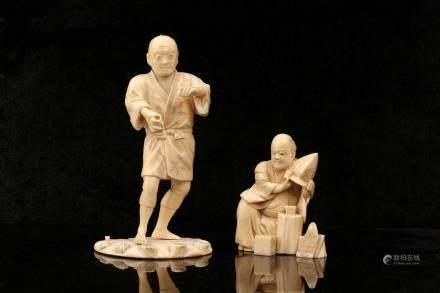 TWO IVORY OKIMONO.
