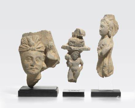 A schist head of a bodhisattva and two schist figures Ancient region of Gandhara, 3rd/4th century