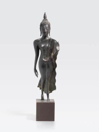 A Sukhothai style bronze walking Buddha