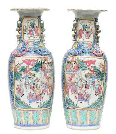 A pair of Chinese famille rose vases, decorated with a battle scene and a scene from court life, H 64 cm (one vase with firing fault inside the neck, one vase with a chip on the bottom rim)