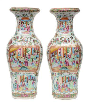A pair of Chinese baluster shaped vases, famille rose decorated with scenes from court life and antiquities, 19thC, H 64,5 cm (one vase with chip to the top rim)