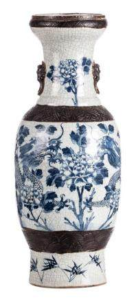 A Chinese blue and white stoneware vase, decorated with dragons and flower branches, marked, 19thC, H 61,5 cm