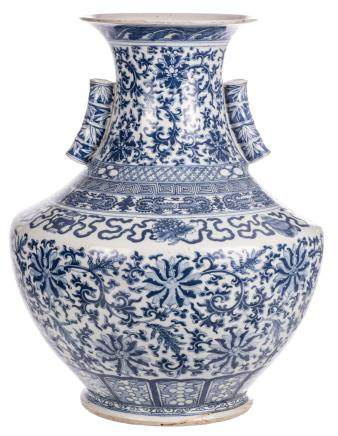 A Chinese blue and white Hu vase, decorated with floral motifs, the handles bamboo moulded, 19thC, H 49,5 cm (chips and firing faults to the top rim and handles)