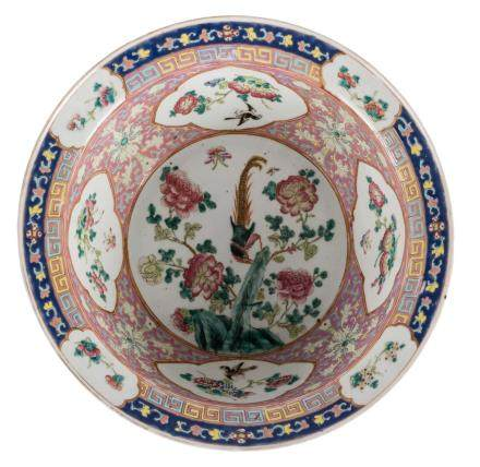 A Chinese famille rose decorated bowl, the roundels with birds and flower branches, 19thC, Diameter 41 cm