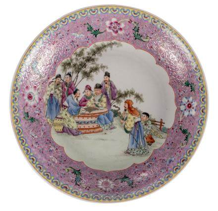 A Chinese famille rose decorated plate with an animated scene and floral motifs, marked, Diameter 37 cm