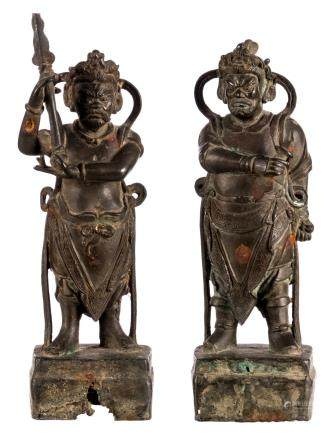 Two Chinese bronze temple guards, Ming, with traces of gilt and polychromy, H 38 - 40,5 cm (damage)
